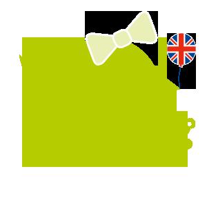 gruenes Kueken mit Union Jack, Schleife und Teddybaer